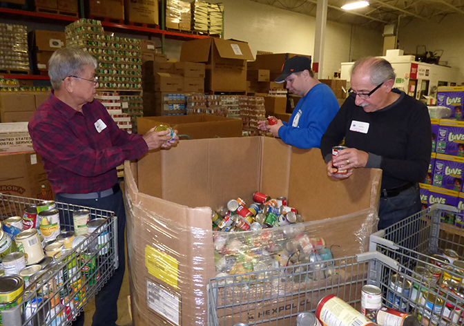 Sorting Can Food Fish and Loaves Food Pantry
